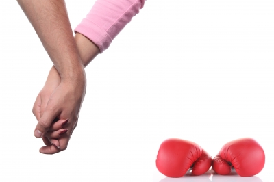 Love and Hate Picture (holding hands next to boxing gloves)